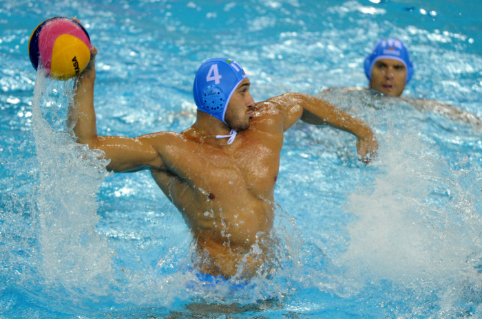 Italy's Pietro Figlioli throws a ball against Serbia during their men's water polo final match of the FINA World Championships at the natatorium of the Oriental Sports Center in Shanghai on July 30, 2011.  Italy won 8-7.     AFP PHOTO/Mark RALSTON