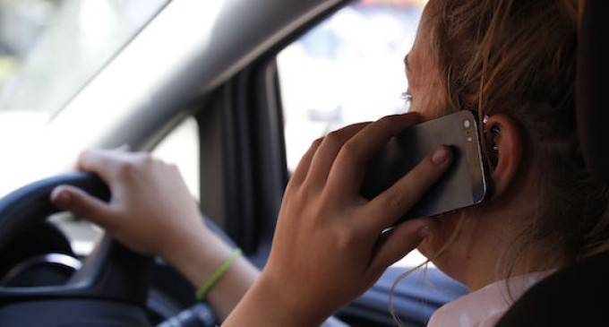 PICTURE POSED BY MODEL  File photo dated 13/08/14 of a woman talking on her phone whilst driving, as the brother of a woman killed by a driver using a mobile phone has spoken of his fear people will think the problem has gone away. PRESS ASSOCIATION Photo. Issue date: Friday April 17, 2015. He spoke out after new figures showed the number of people given penalty points for the offence has fallen by almost a quarter. See PA story POLICE Mobile. Photo credit should read: Jonathan Brady/PA Wire